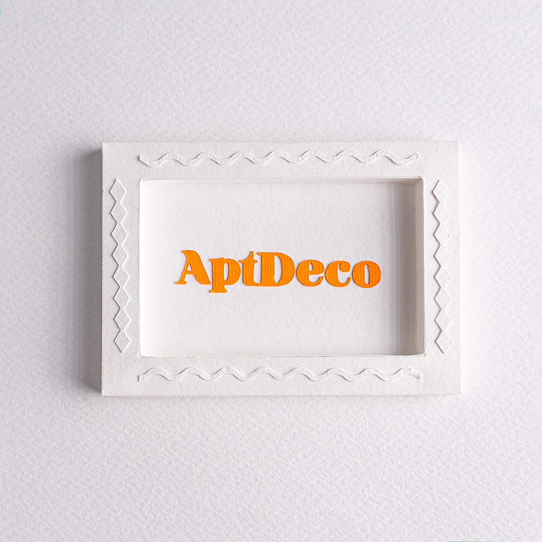 paper made frame with aptdeco logo inside