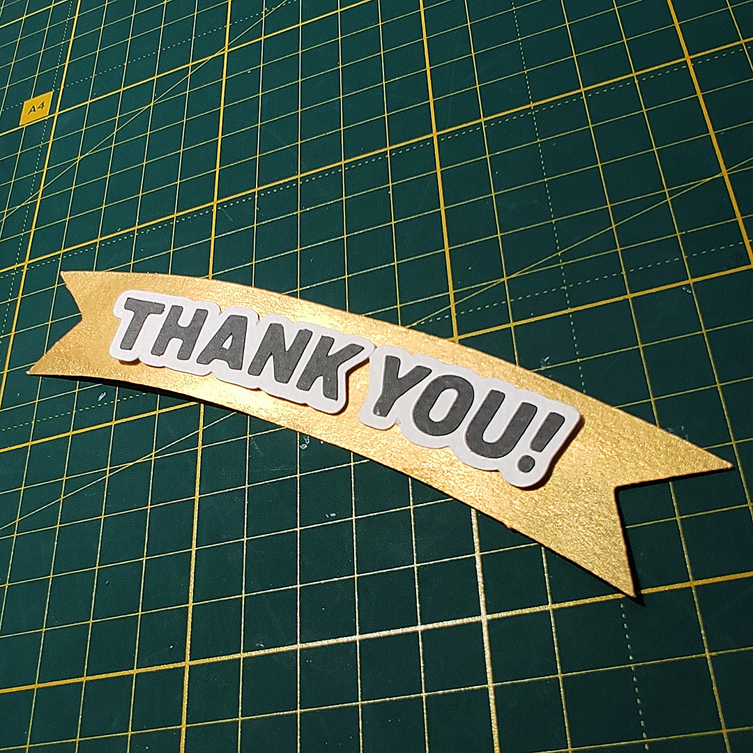 paper cut ribbon painted with gold paint